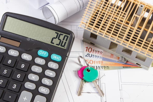 House under construction, keys, calculator and currencies euro on electrical drawings and diagrams - Stock Photo - Images