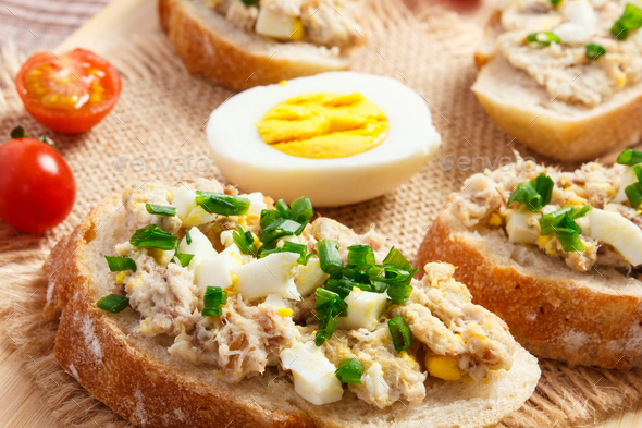 Crispy baguette or sandwiches with mackerel or tuna fish paste - Stock Photo - Images