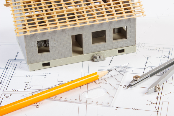 House under construction and accessories for drawing on electrical diagrams for project - Stock Photo - Images