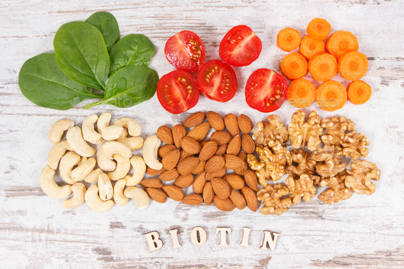 Inscription biotin with nutritious products containing vitamin B7 and dietary fiber - Stock Photo - Images