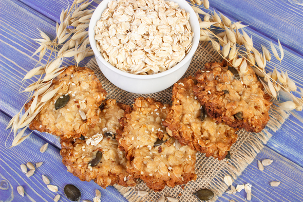 Fresh baked oatmeal cookies, flakes and ears of oat, healthy dessert concept - Stock Photo - Images