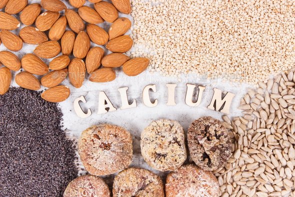 Inscription calcium and natural food containing minerals and dietary fiber - Stock Photo - Images
