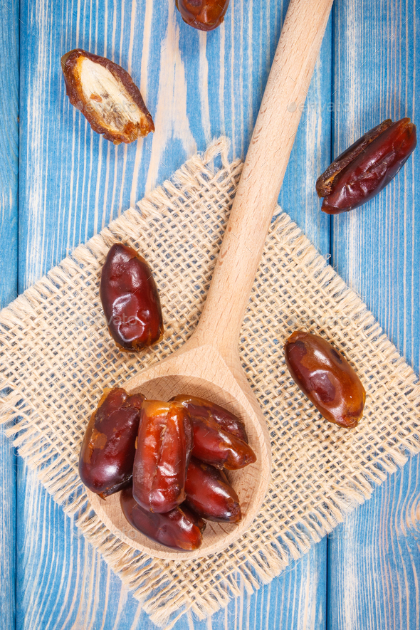 Heap of dates as source natural vitamins, minerals and dietary fiber, healthy nutrition - Stock Photo - Images