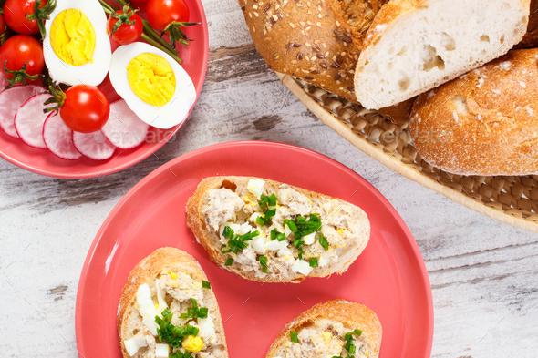 Baguette with mackerel fish paste, egg, tomato, radish and fresh rolls - Stock Photo - Images