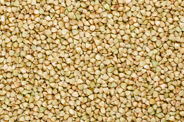 Hulled common buckwheat grains surface from above - Stock Photo - Images