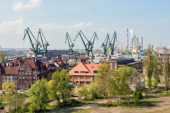 GDANSK, POLAND, May 14, 2018: A view of Gdansk shipyard and the green cranes. - Stock Photo - Images