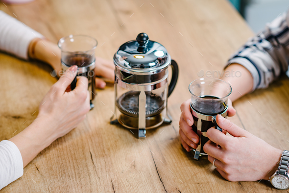 Girlfriends having coffee together - Stock Photo - Images