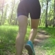 Young Female Athlete Jogging in Forest. Woman Doing Morning Physical Training. - VideoHive Item for Sale