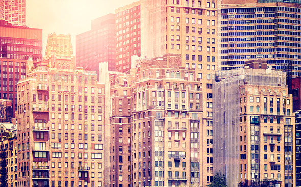 New York high-rise buildings at sunset, USA. - Stock Photo - Images