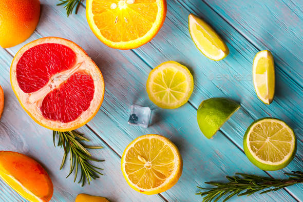 Pattern of slice citrus on blue wooden background - Stock Photo - Images