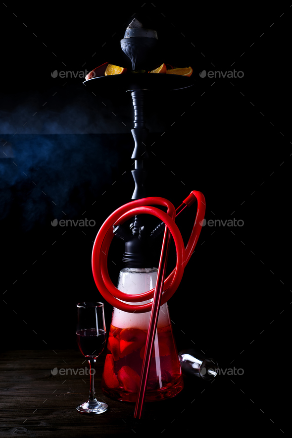 Stylish oriental shisha with fruits on a black background. Shisha Concept - Stock Photo - Images