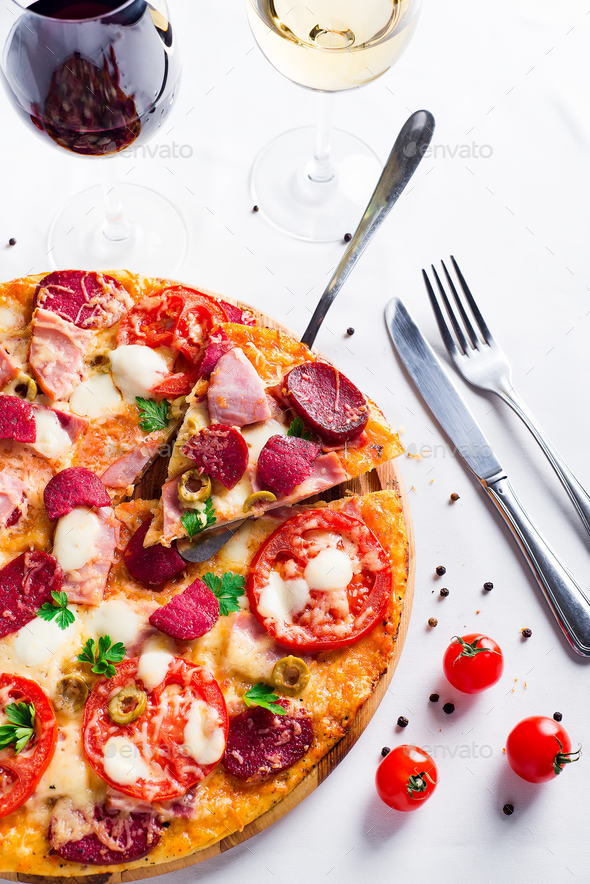 Hot pizza with Pepperoni Sausage on a white table - Stock Photo - Images