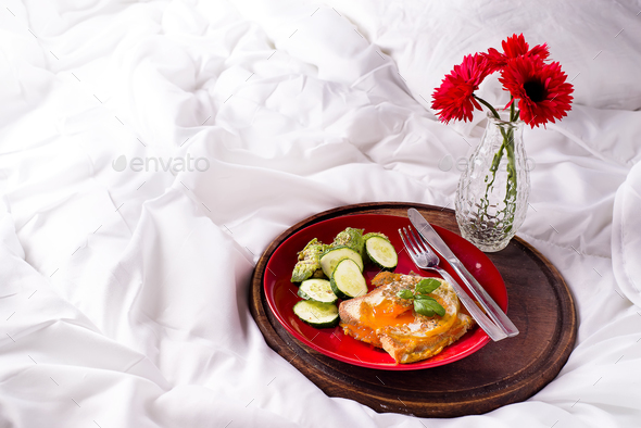 Healthy breakfast served to bed with flowers - Stock Photo - Images