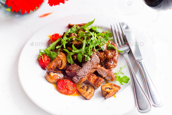Juicy steak medium rare beef with spices and grilled vegetables. - Stock Photo - Images