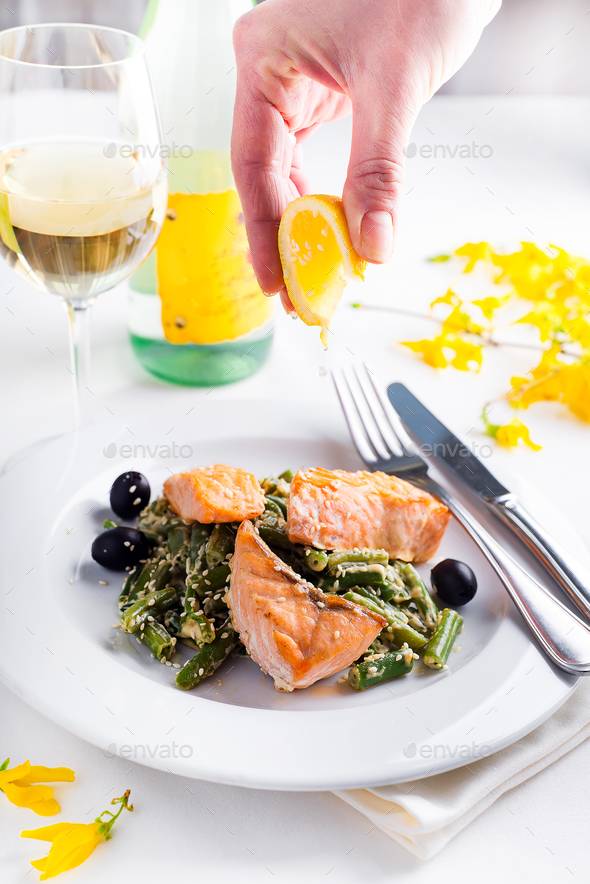 Grilled salmon with steamed green beans and lemon - Stock Photo - Images