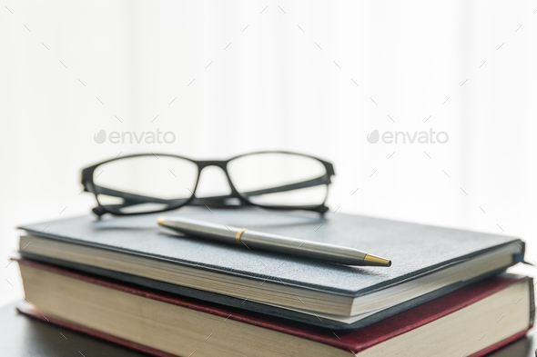 Glasses and book on the desk-2 - Stock Photo - Images