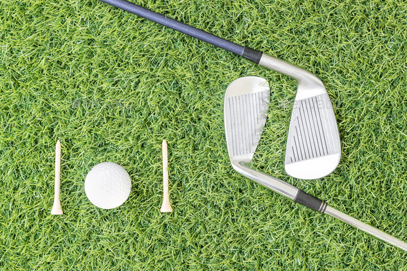 Golf club and golf ball on green grass-7 - Stock Photo - Images