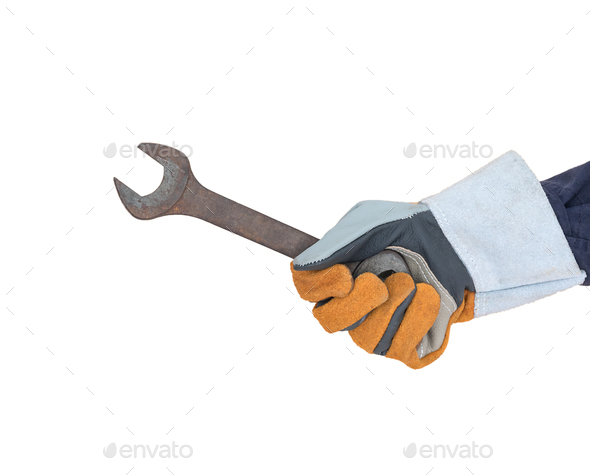 Hand in glove holding spanner on white - Stock Photo - Images