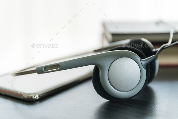 Headphones with book and mobile phone_-2 - Stock Photo - Images