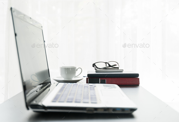 Laptop placed on desktop with coffee cup-3 - Stock Photo - Images