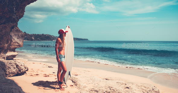 Sportive woman with surfboard - Stock Photo - Images
