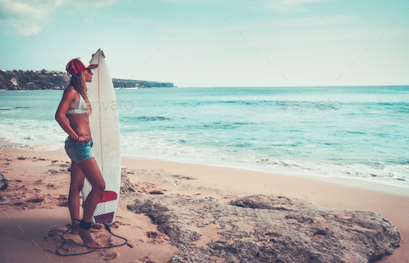 Beautiful surfer girl on the beach - Stock Photo - Images