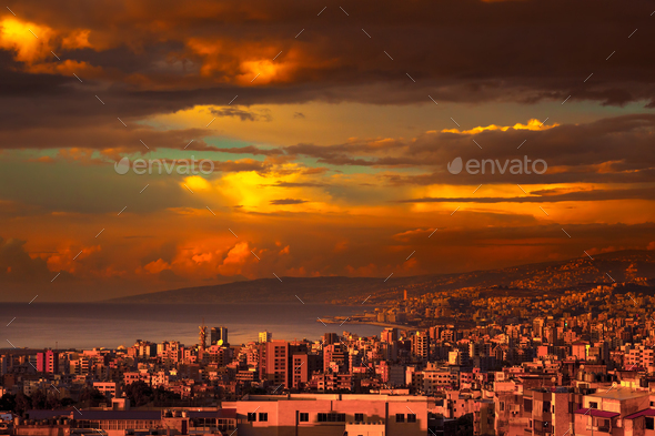 Beautiful coastal city on sunset - Stock Photo - Images