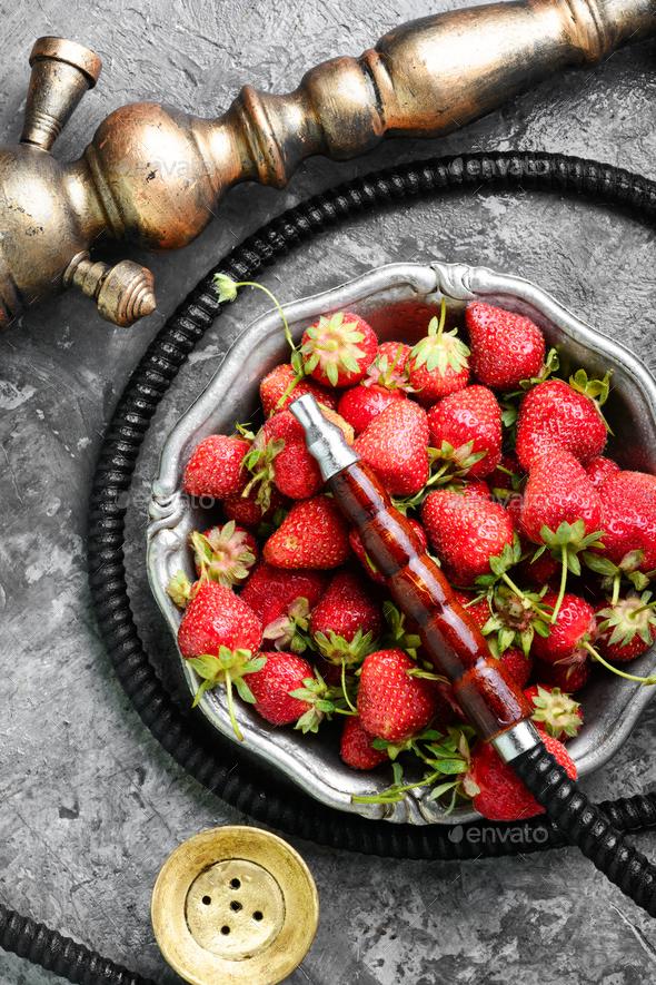 Stylish oriental shisha with strawberry - Stock Photo - Images