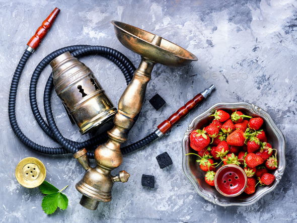 Stylish oriental shisha with strawberry - Stock Photo - Images