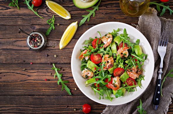 Fresh salad bowl with shrimp, tomato, avocado and arugula - Stock Photo - Images
