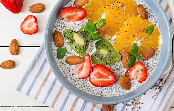 Vegan almond milk chia seeds pudding with strawberries, orange and  kiwi. - Stock Photo - Images