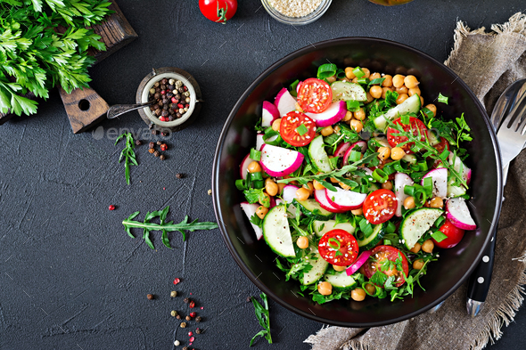 Salad of chickpeas, tomatoes, cucumbers, radish and greens - Stock Photo - Images