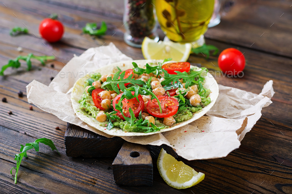 Vegan tacos with guacamole, chickpeas, tomatoes and arugula. Healthy food. Useful breakfast - Stock Photo - Images