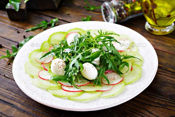 Carpaccio of radish with arugula, mozzarella and  sauce. Healthy food. Daikon salad - Stock Photo - Images
