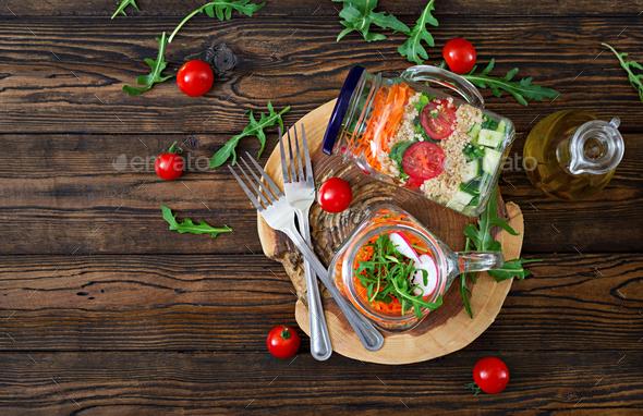 Salads with quinoa,  arugula, radish, tomatoes and cucumber - Stock Photo - Images