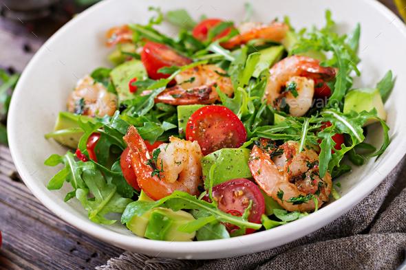 Fresh salad bowl with shrimp, tomato, avocado and arugula  - Stock Photo - Images