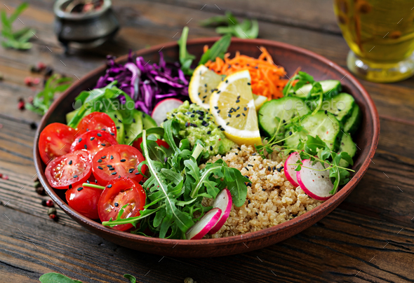 Vegetarian Buddha bowl with quinoa and fresh vegetables. Healthy food concept. Vegan salad. - Stock Photo - Images
