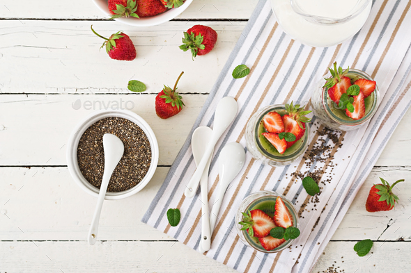 Vegan coconut milk chia seeds pudding with strawberries and kiwi.  - Stock Photo - Images