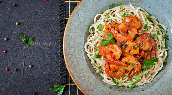 Pasta spaghetti with shrimps, tomato and chopped parsley.  - Stock Photo - Images