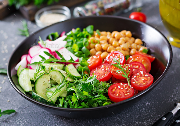 Salad of chickpeas, tomatoes, cucumbers, radish and greens. Dietary food. Buddha bowl. Vegan salad. - Stock Photo - Images
