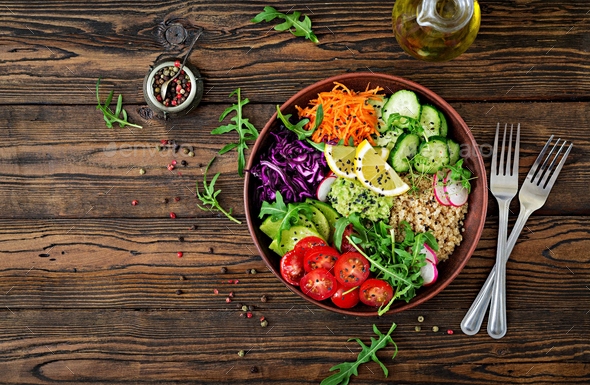 Vegetarian Buddha bowl with quinoa and fresh vegetables - Stock Photo - Images