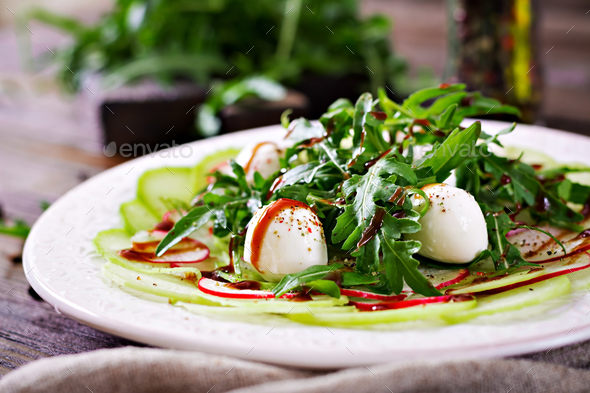 Carpaccio of radish with arugula, mozzarella and balsamic sauce. Healthy food. Daikon salad. - Stock Photo - Images