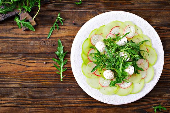 Carpaccio of radish with arugula, mozzarella and  sauce - Stock Photo - Images