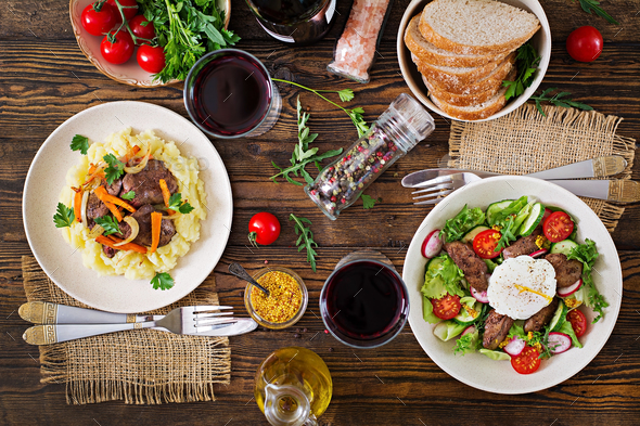 Warm salad from chicken liver, radish, cucumber, tomato and egg poached. - Stock Photo - Images
