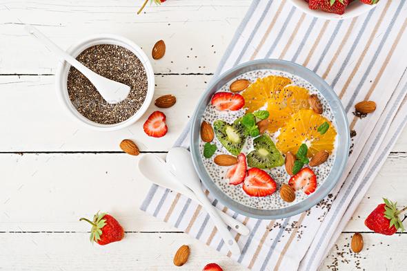 Vegan almond milk chia seeds pudding with strawberries, orange and  kiwi - Stock Photo - Images
