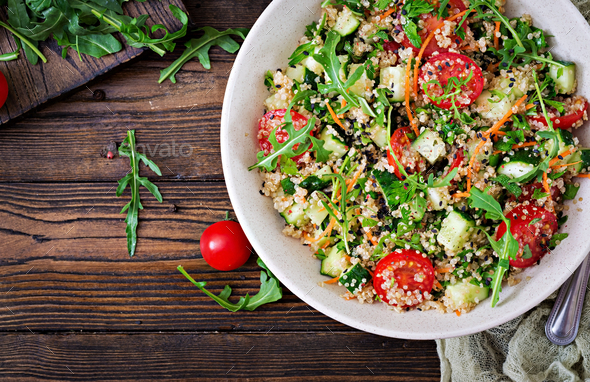 Salads with quinoa,  arugula, radish, tomatoes and cucumber - Stock Photo - Images