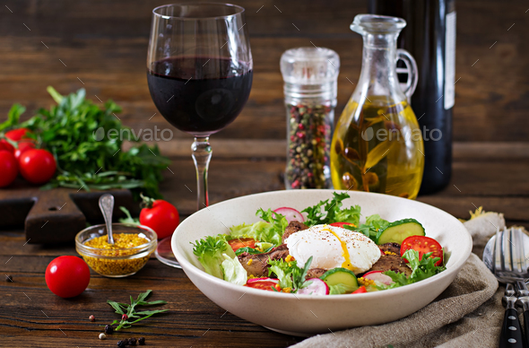 Warm salad from chicken liver, radish, cucumber, tomato and egg poached. Healthy food. Dietary menu - Stock Photo - Images