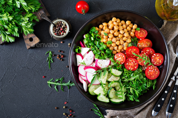 Salad of chickpeas, tomatoes, cucumbers, radish and greens. - Stock Photo - Images