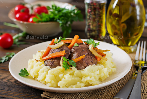 Fried chicken liver with vegetables and garnish of mashed potatoes. Healthy food - Stock Photo - Images