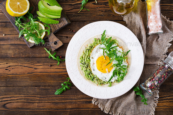 Tacos with guacamole, fried egg and arugula. Healthy food. Useful breakfast. Flat lay. Top view - Stock Photo - Images